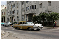 Gold and white car, corner of 25th Street and L Street.