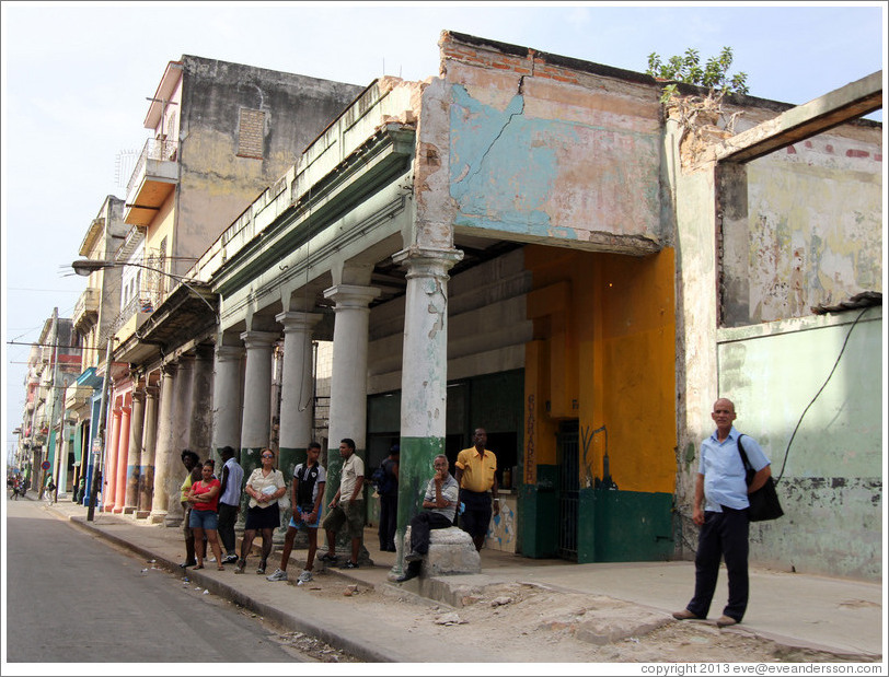 People standing near columns of a building, Calle Padre Varela (Belonscoain).