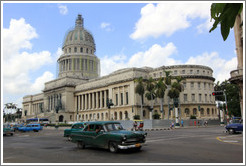 Green cars in front of El Capitolio.