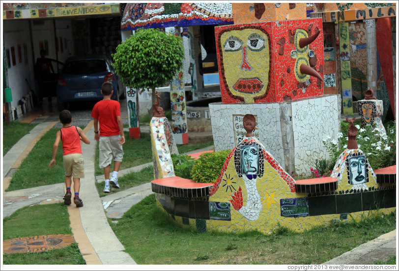 Two boys, and red block with yellow face, Fusterlandia.