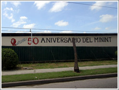 "Words painted on a wall: ""50 Aniversario del MININT"" (Cuba's Ministry of the Interior). Calle Perla, La Víbora neighborhood."