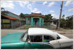 Aqua house and green and white car, Calle Perla, La Víbora neighborhood.