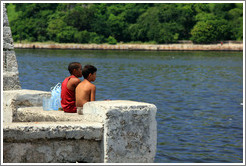 Two boys sitting on the Malecón.