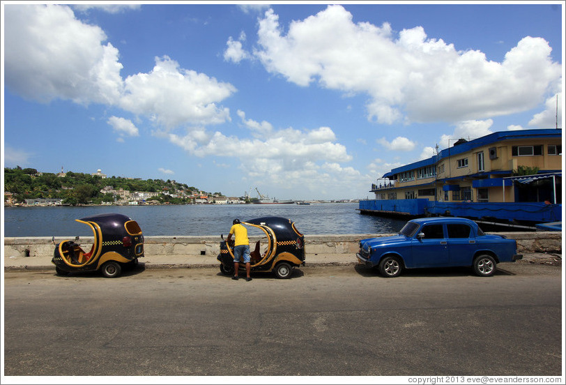 Coco taxis and blue car, Malecón.