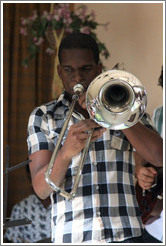 Trombonist Eduardo Sandoval, performing at a private home in Miramar.
