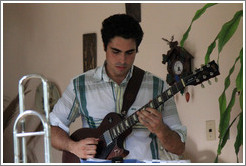 Guitarist Hector Quintana, performing at a private home in Miramar.