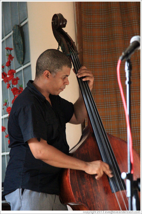 Double bassist Omar Gonzales, performing at a private home in Miramar.