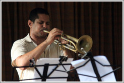 Trumpet player Yasek Manzano Silva, performing at a private home in Miramar.