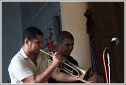 Trumpet player Yasek Manzano Silva and double bassist Omar Gonzales, performing at a private home in Miramar.