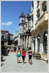 Three women walking down Calle Empedrado, Old Havana.