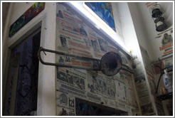 Trombone in front of newspaper clippings, Proyecto Salsita.