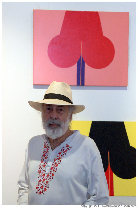 Cuban artist Juan Moreira in front of his artwork in the studio he shares with Alicia Leal.