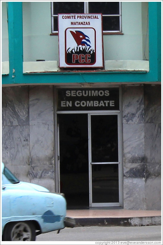"Sign above door reading, ""Seguimos en combate"" (""We continue in combat"") near Parque de la Libertad (Liberty Park)."