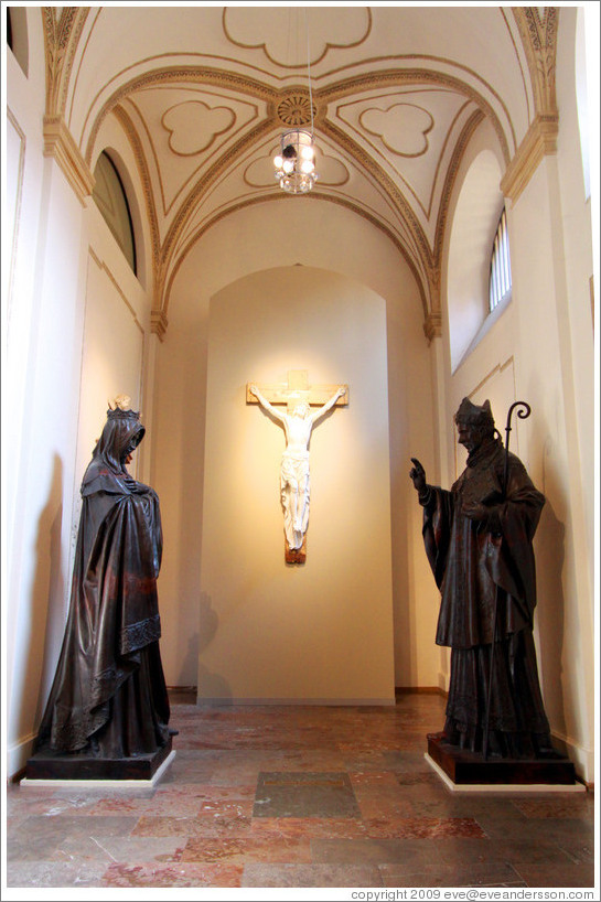 Plaster cast of St. Adalbert (Vojtěch) sculpture and model of a St. Agnes sculpture by Josef V?av Myslbek.  Behind is Christ on a Cross (1843) by Emanuel Max.  National Gallery, Prague Castle.