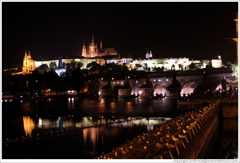 Prague Castle across the Vltava River at night.