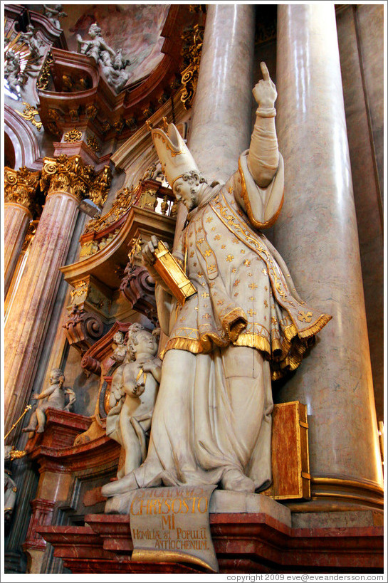 Sculpture of St. John Chrysostom pointing upward, St. Nicholas' Church (Kostel sv. Mikul?), Mal?trana.