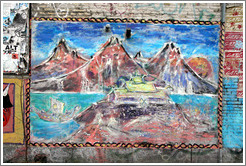 Painting of mountains on a wall.