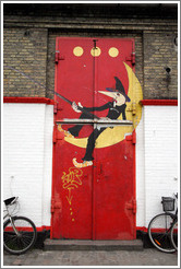 Door of the Moonfisher Cafe, with the three dots symbolizing Christiania at the top.