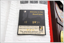 Sign: Welcome to the Moonfisher; More than 6000 armed police inspections since 2004; The world's safest cafe.