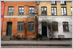 Brick houses, orange, yellow, and off-white.  Neighborhood near Sankt Pauls Kirke, city centre.