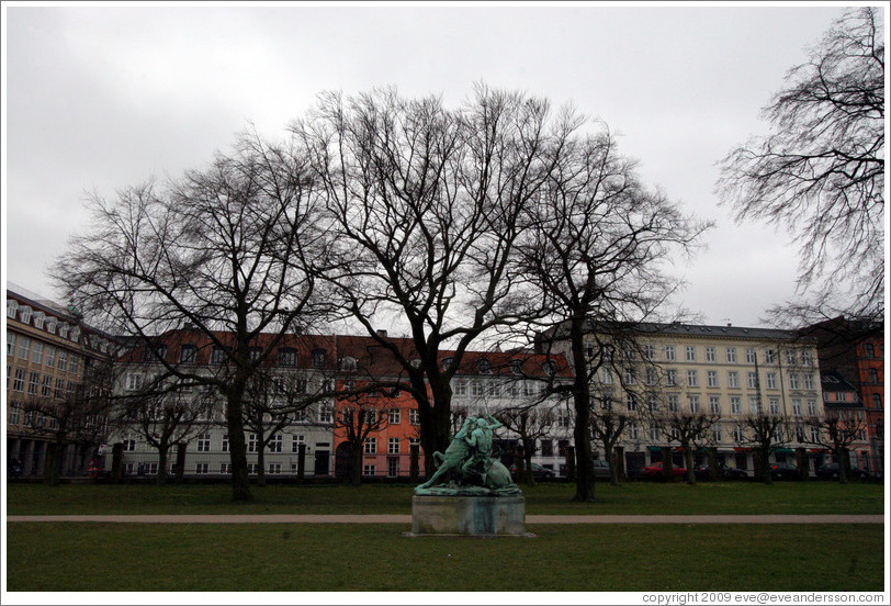 Kongens Have (King's Gardens).  In the distance is Kamp med en slange, a statue by Thomas Brock.  Portrays a Native American attempting to spear a snake that has wrapped itself around his horse.