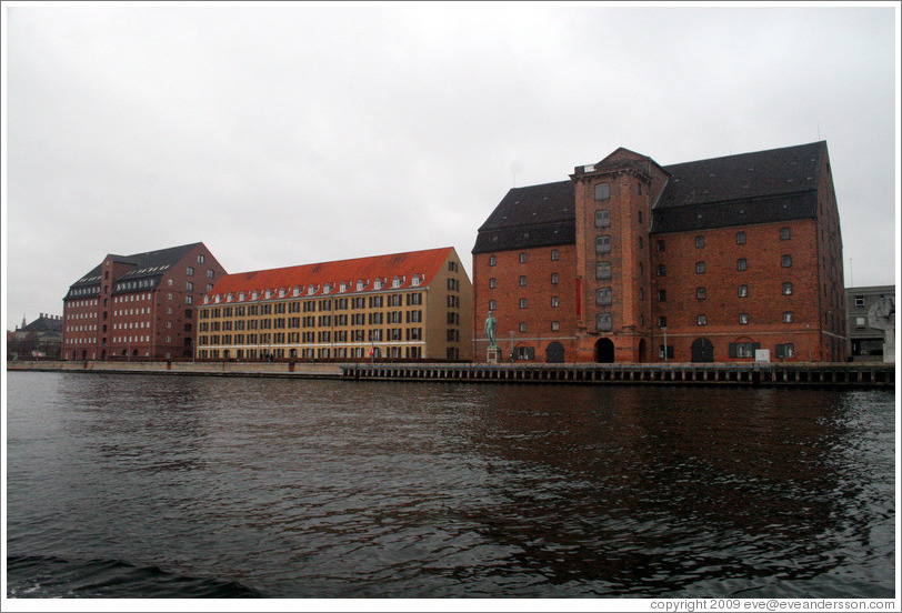 Vestindisk Pakhus, a restored warehouse overlooking Copenhagen harbour.  In front of it stands a replica of Michelangelo's David.