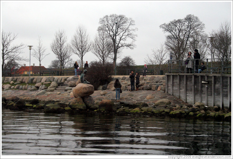 Tourists photographing themselves and The Little Mermaid.  Copenhagen harbour.