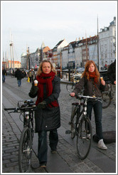 Girls with ice cream cones and bicycles.  Nyhavn (New Harbor).