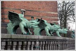 Dragon-like figures in front of R?us (Town Hall).