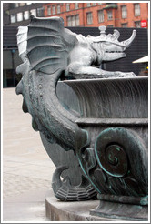 Dragon-like figure on fountain in front of R?us (Town Hall).
