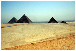 The Pyramids of Giza.  From left to right: Pyramid of Khufu (the Great Pyramid of Giza), Pyramid of Khafre, Pyramid of Menkaure, and Pyramids of Queens.