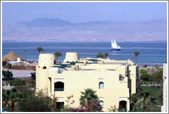 Marriott Hotel, with sailboat and the mountains of Saudi Arabia in the background.