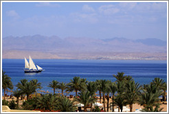 Sailboat in the Red Sea near Taba Heights.  The mountains of Saudi Arabia are in the background.