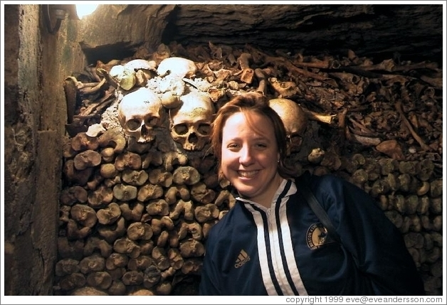 Tracy, looking quite happy to be surrounded by skulls and bones, Paris catacombs.