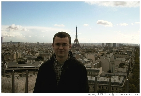 Rolf on top of the Arc de Triomphe, with the Eiffel Tower in the background.