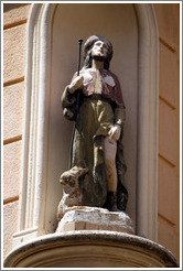 Oratory on a building at the intersection of Rue Cardinale and Rue d'Italie.  Depicts a man, possibly with a hare. Quartier Mazarin.