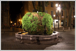 Fontaine d'eau Chaude (Warm Water Fountain) at night.  Built in 1734, fed by a hot spring.  Cours Mirabeau.