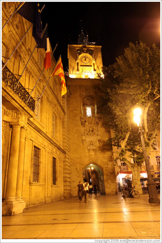 Clock tower, the former town belfry, containing an astronomical clock dating from 1661, at night.  Adjoining the H? de ville (city hall).