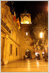 Clock tower, the former town belfry, containing an astronomical clock dating from 1661, at night.  Adjoining the H�tel de ville (city hall).