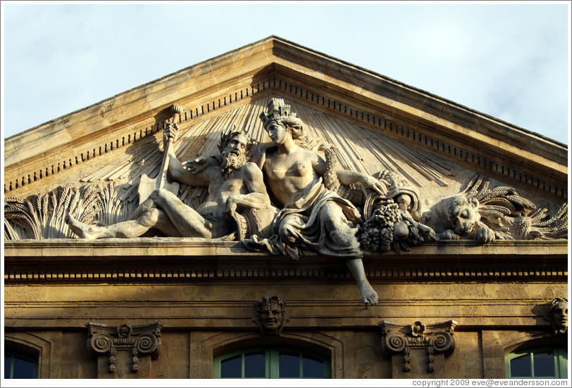 Figures representing the Rhone and Durance rivers.  Halle aux Grains (the former Grain Exchange, 1759-61).  Place de l'H? de Ville (city hall plaza).