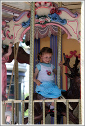 Girl on the merry-go-round.  Place de la Rotonde.