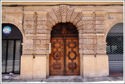 Embossed pattern around the doors of the H�tel de Peyronetti (1620).  Rue de l'Aude.  Old town.