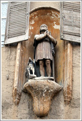 Oratory depicting a man and a dog.  Rue Espariat at Rue de la Masse.  Old town.