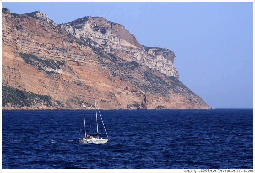 Sailboat in front of the calanques of Marseilles, viewed from Cassis.