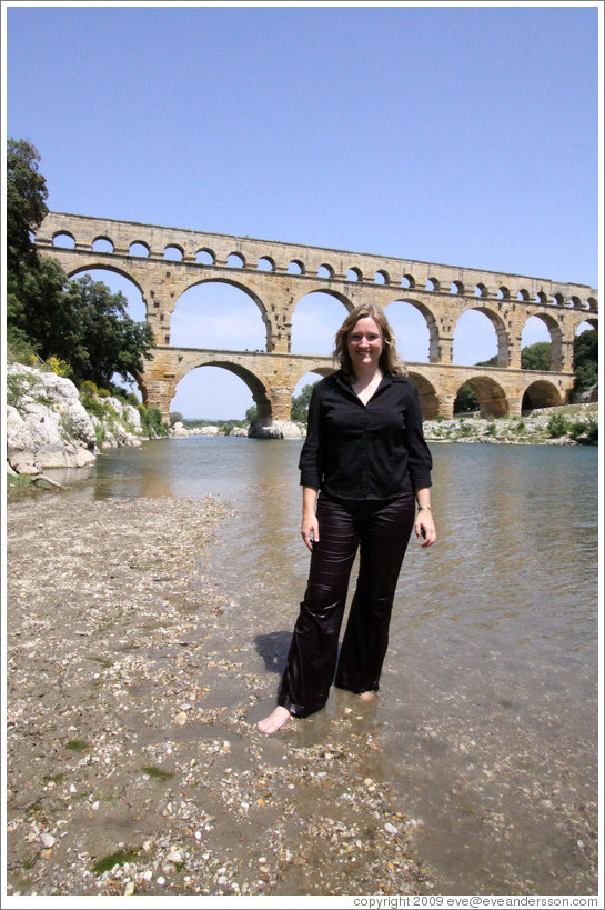Eve, soaking wet after getting into the water chest-deep to photograph the Pont du Gard.