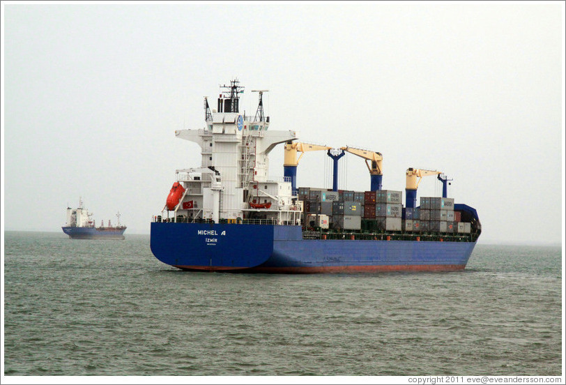 "Cargo ship with the name ""Michel"" printed on it."