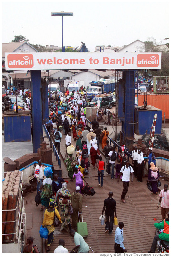 "Ferry sign: ""Welcome to Banjul""."