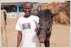 Employee of the Gambia Horse & Donkey Trust with horse named Lazarus.