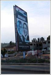 Billboard reading Akwaaba / Partnership for Change, with photos of the president of Ghana, John Atta Mills, and the president of the United States, Barack Obama.