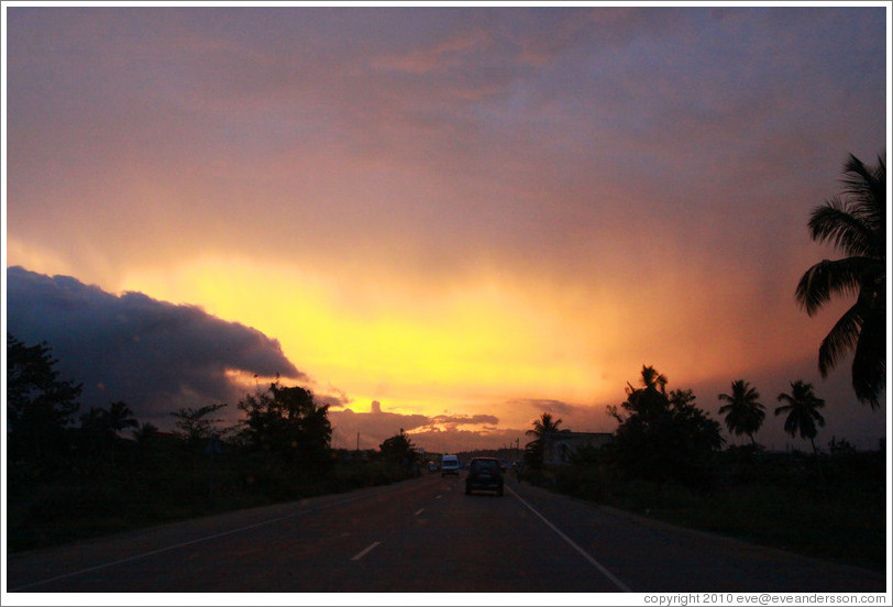 Sunset over Cape Coast road.